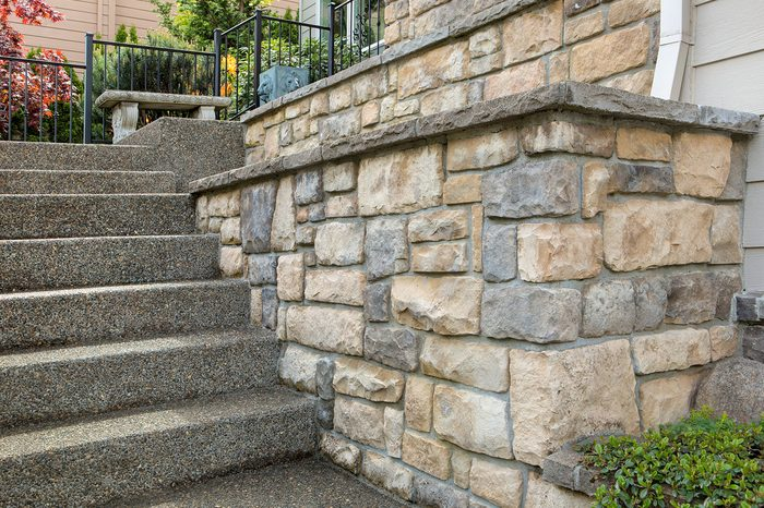 Cultured stone work on front of house in suburban residential neighborhood