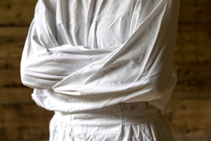 Woman with straitjacket, dark background