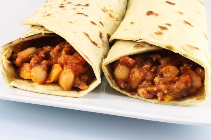 Tortillas with beans, beef and tomatoes close up