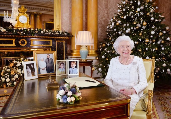 Queen Elizabeth II sits at a desk in the 1844 Room at Buckingham Palace, London, after recording her Christmas Day broadcast to the Commonwealth