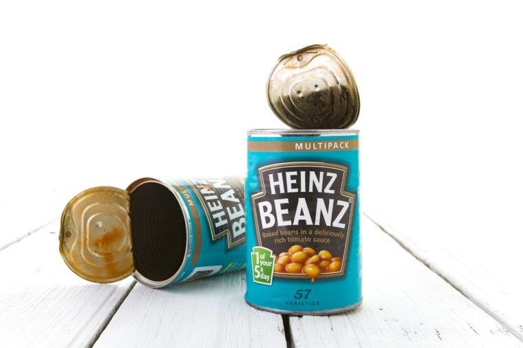 SWINDON, UK - April 10, 2016: Heinz Baked Beanz On a White Wooden Background