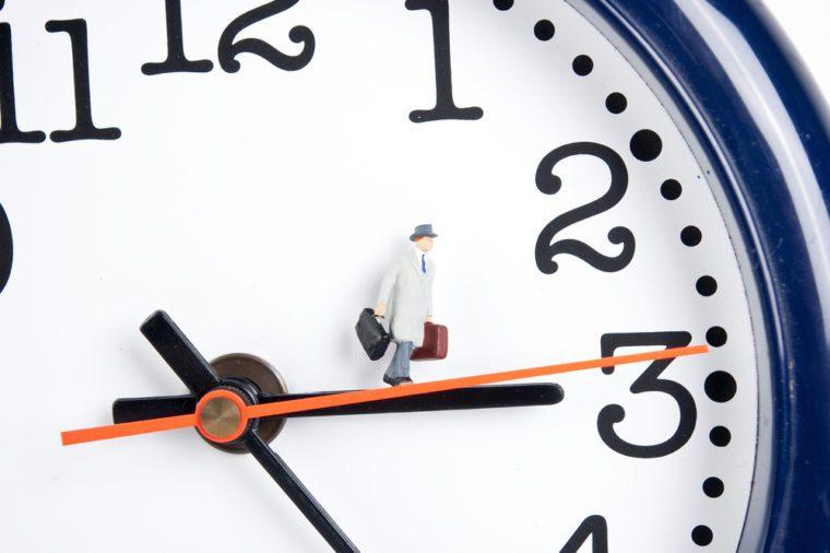 traveler on clock in time