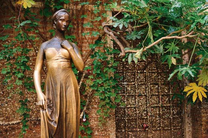 VERONA, ITALY - MAY, 2017: Patio and statue Juliet, Verona, Italy. Very popular tourist place.