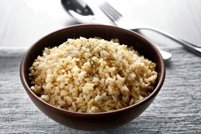 Bowl full of brown rice on napkin