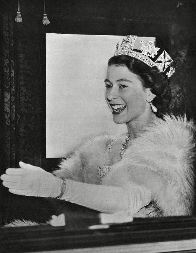 Historical Collection 174 Queen Elizabeth Ii Wearing A Fur Stole and the George Iv State Diadem Waves to Crowds From Her Coach On the Way to Westminster For the State Opening of Parliament 1952