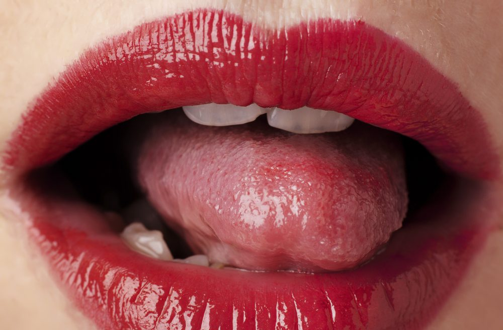 close up image of womans red lips