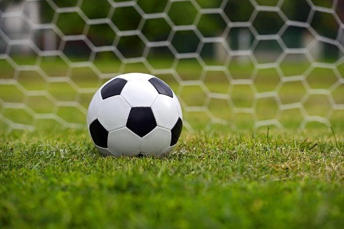 Leather soccer ball on a football stadium