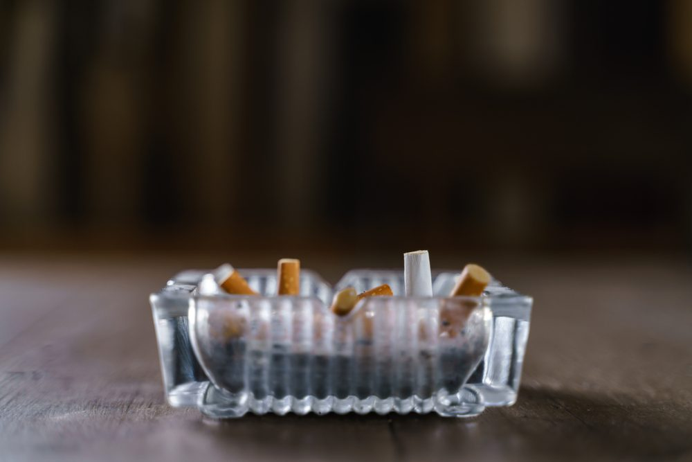 Glasses cigarette ash tray on wooden table