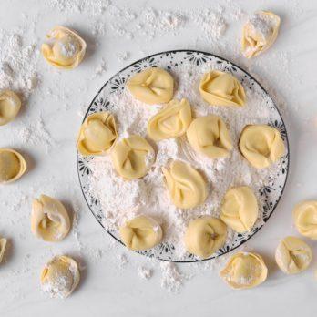 ravioli and flour dish on marble