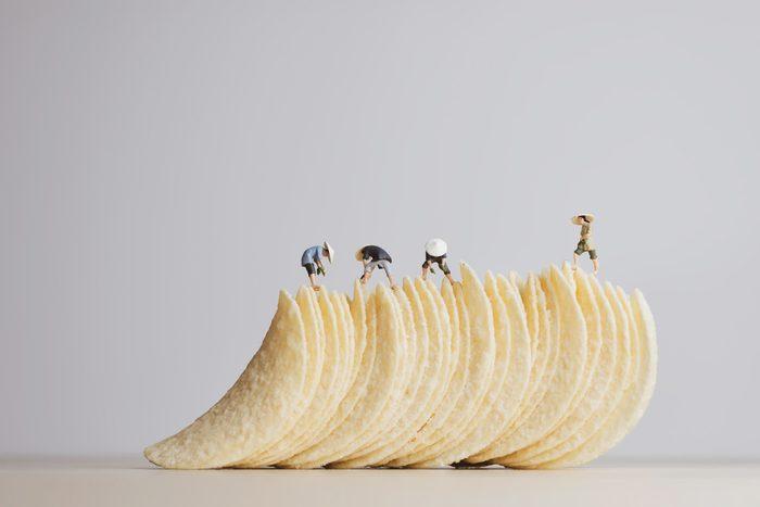 Potato chips making concept. Macro photo