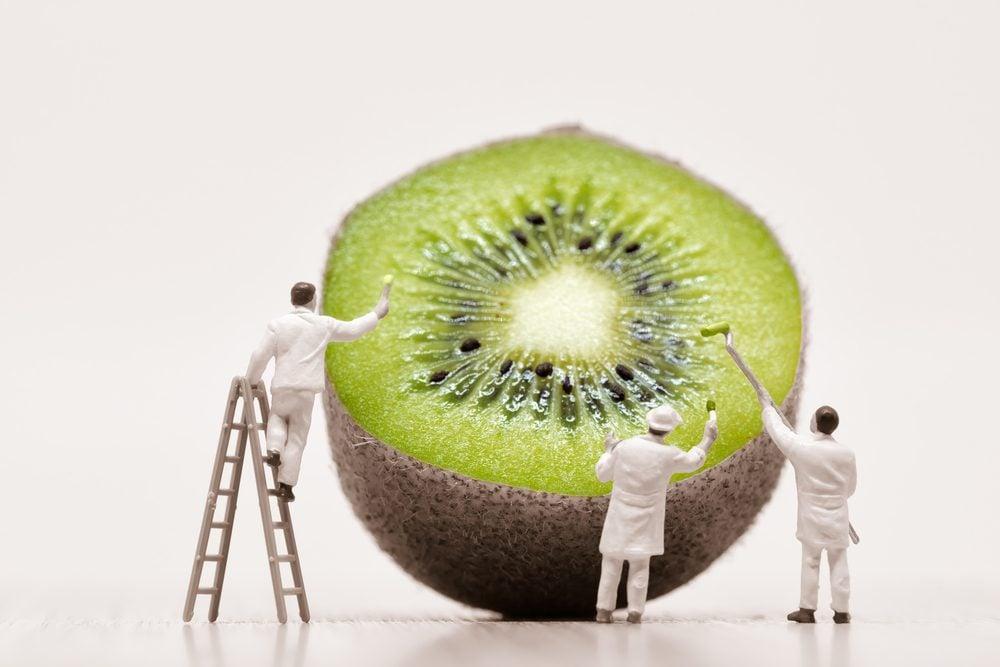 Painters coloring kiwi. Macro photo.