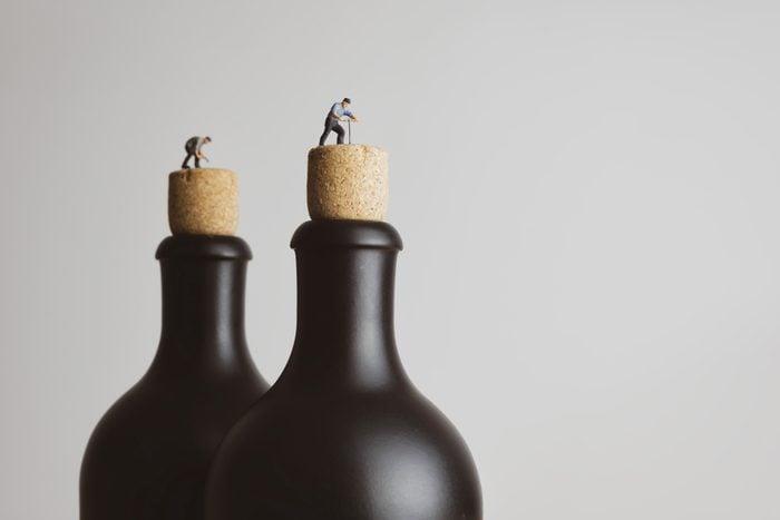 Retro-style people open up a black bottle