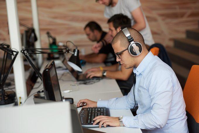 startup business, software developer working on computer at modern office