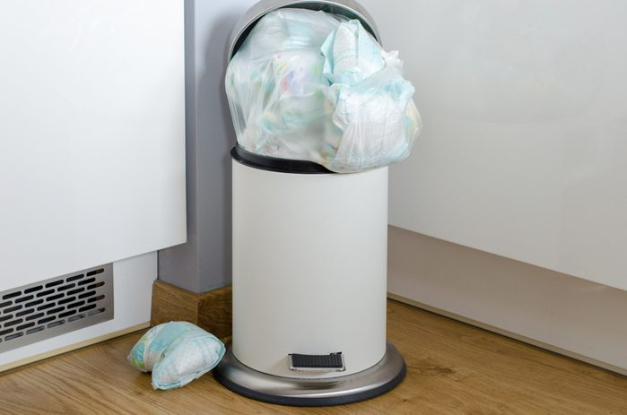 garbage can full of used dirty diapers