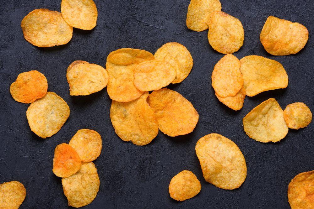 Potato chips on dark background