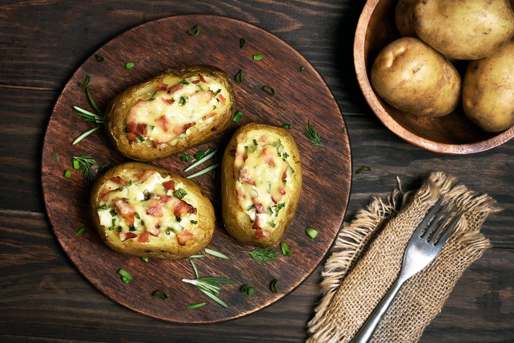 Baked stuffed potatoes with bacon, green onion and cheese, top view