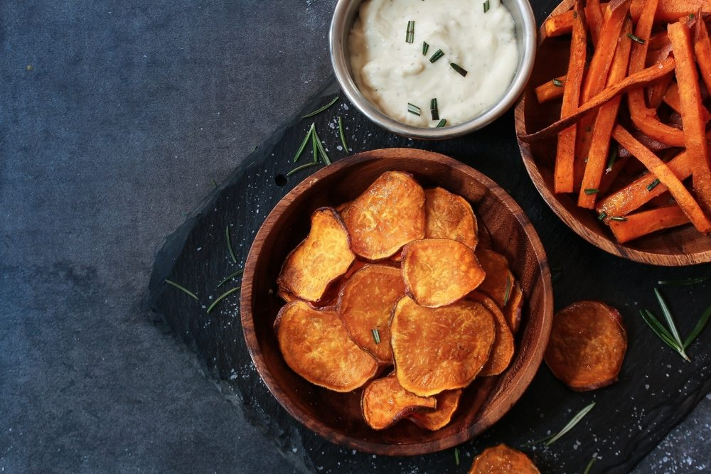 Homemade Sweet potato chips and fries served with dips / Thanksgiving food