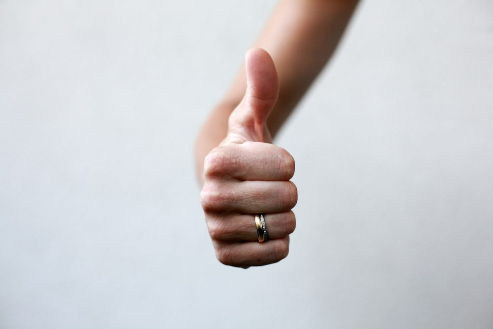 thumbs up , bright background