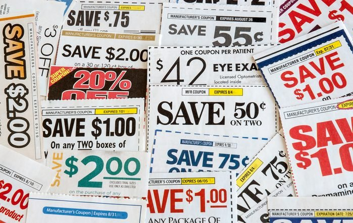 Colorful clipped multi valued grocery coupons. Supermarket shopping.