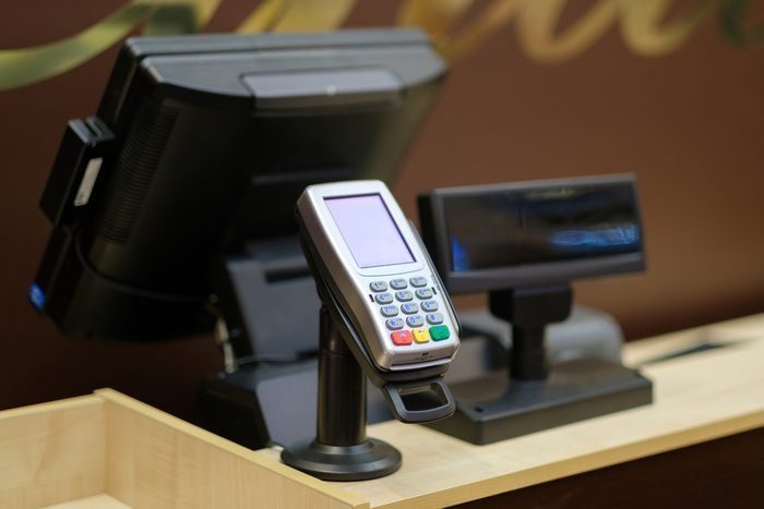 Cash desk with screen and card payment terminal in mall