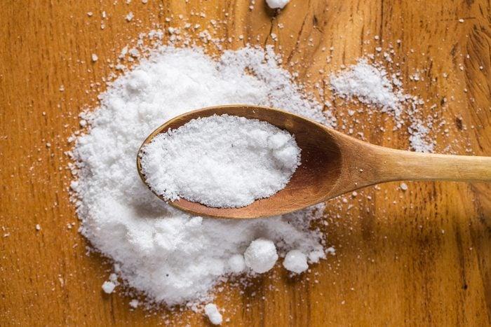 Spices. Heap of salt on the table