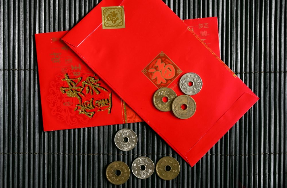 Red envelopes and coins for Chinese New Year