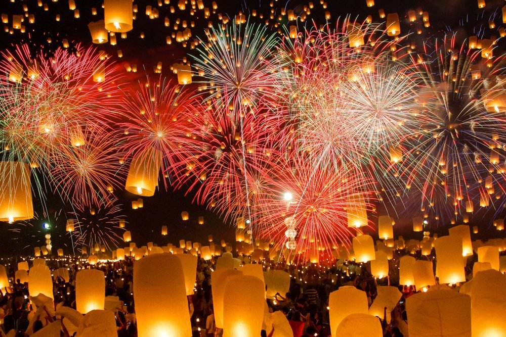 Sky lanterns with fireworks, flying lanterns, hot-air balloons