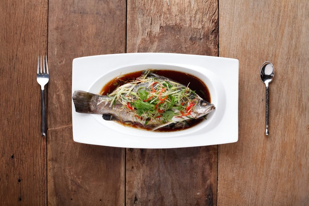 White Pomfret Steamed Dish with chinese sauce,Ready to eat. On The Table