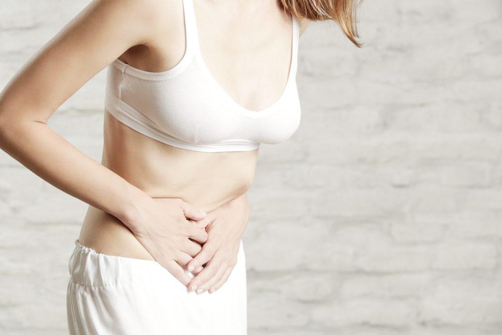 Woman having painful stomachache, chronic gastritis or abdomen bloating