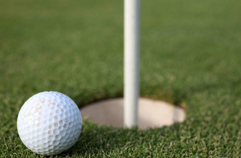 golf - white ball and tee