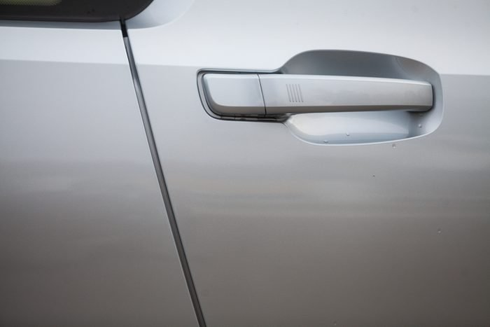 Color detail of a white car door handle.