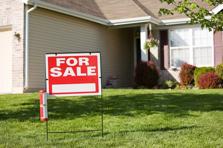 Real Estate: For Sale Sign In Front Of House