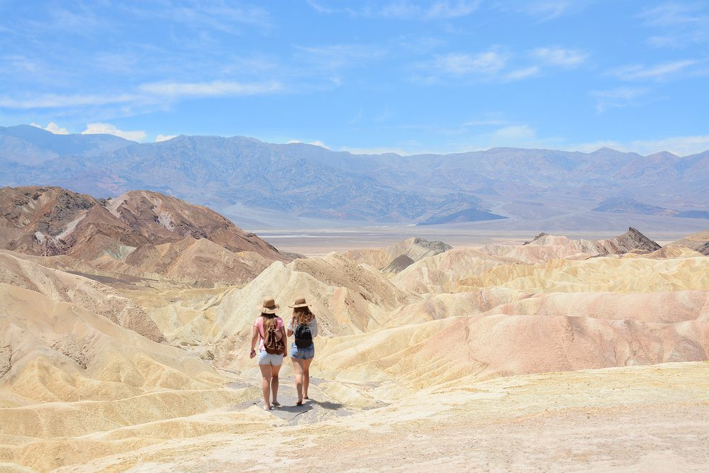 Friends hiking in the mountains on vacation trip. Death Valley National Park landscape , eastern California and Nevada, USA.