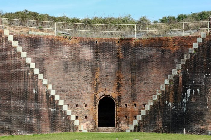 Steps on brick wall of 1834 Fort Morgan form a v-shape, Mobile Point, Alabama, USA