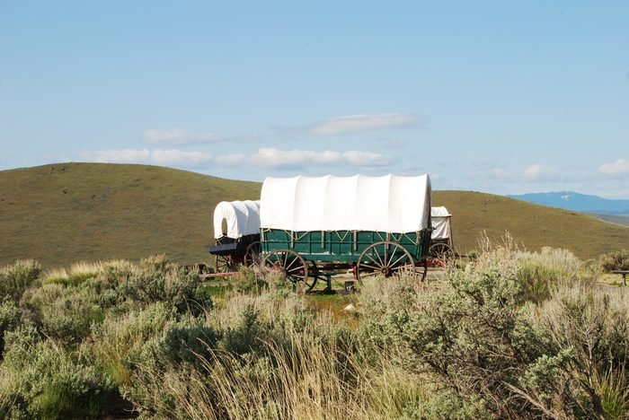 The National Historic Oregon Trail Interpretive Center near Baker City Oregon. Wagons at the Center with the Blue Mountains in the background