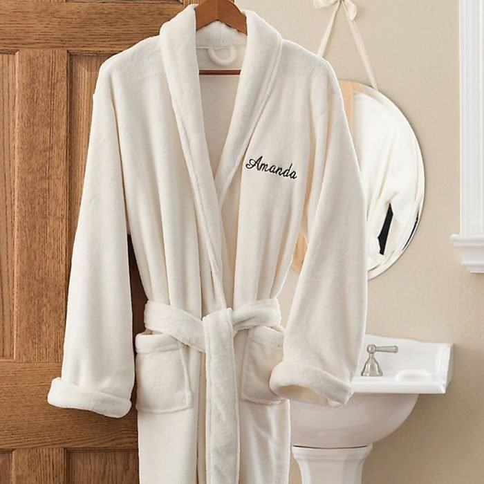 Bath robe hanging on bathroom door