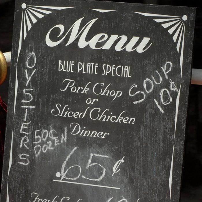 A retro style menu written with chalk on a blackboard