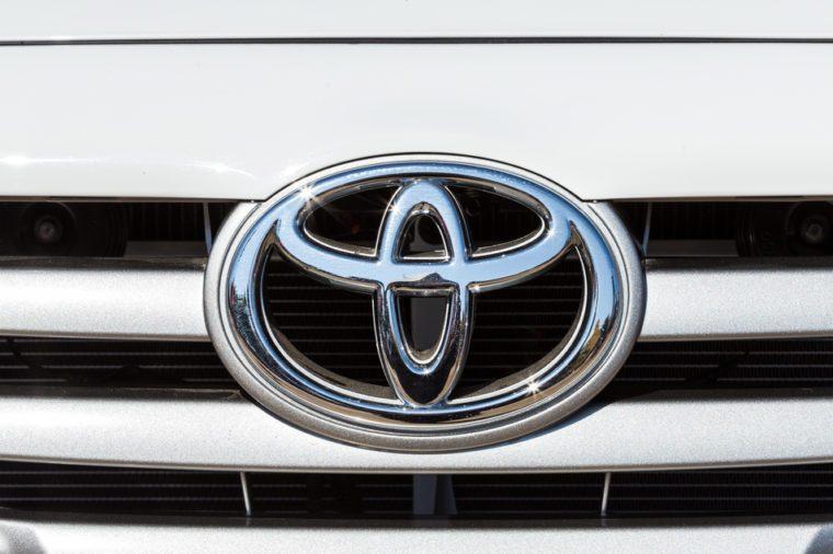 CHIANGRAI, THAILAND - DECEMBER 31, 2014 : Logo of Toyota car on display at Chiang Rai ASEAN flower festival 2014