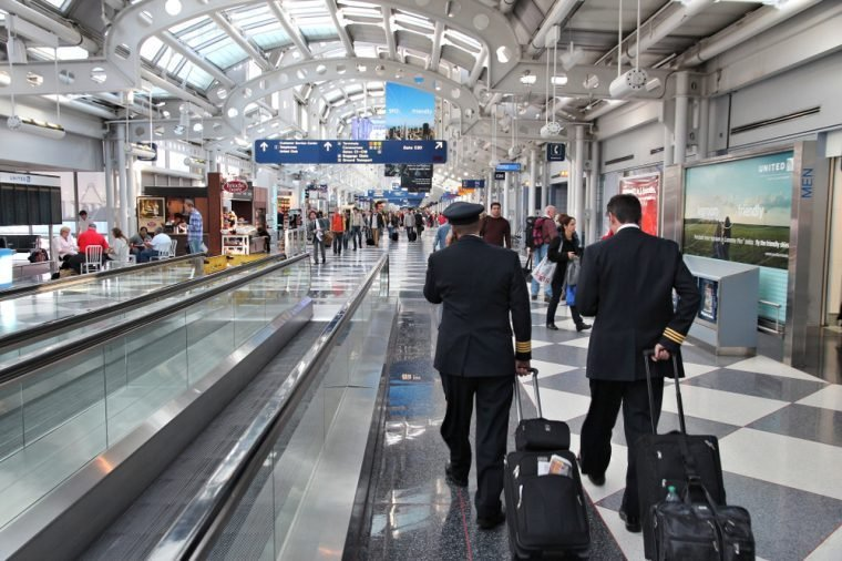 CHICAGO, USA - APRIL 1, 2014: Pilots walk to gate at Chicago O'Hare International Airport in USA. It was the 5th busiest airport in the world with 66,883,271 passengers in 2013.