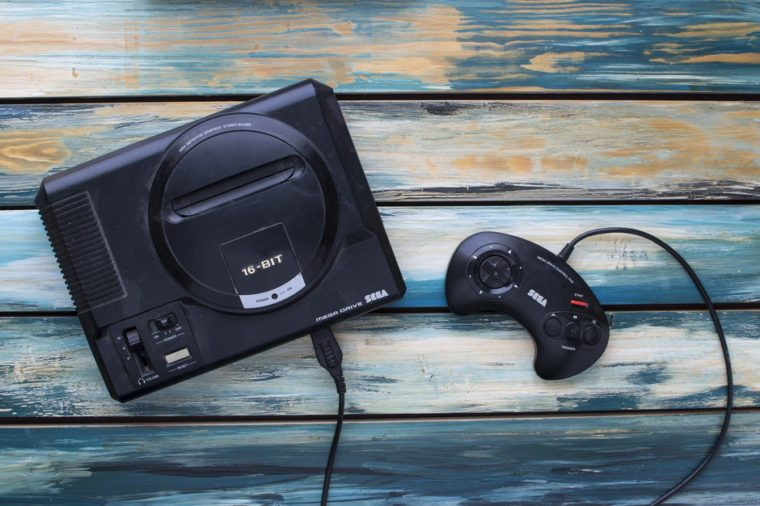 CLEETHORPES, UK - February 28 2017: A studio shot of a Sega Mega Drive game console, a 16-bit video games machine that was popular in the late 80s and early 90s