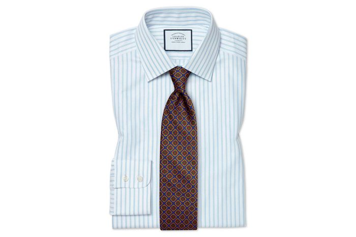 mens button down shirt folded with tie