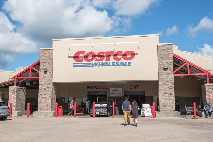 HOUSTON, US - SEP 10, 2016: Costco Wholesale storefront with customers walk in. Costco Wholesale Corporation is largest membership-only warehouse club in US. It has a total of 705 warehouses worldwide