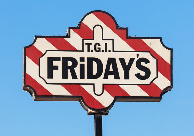KUWAIT - DEC 8: T.G.I's Friday sign in Kuwait City. TGI Fridays is an american themed restaurant chain which is popular in arabic countries. December 8, 2014 in Kuwait, Middle East