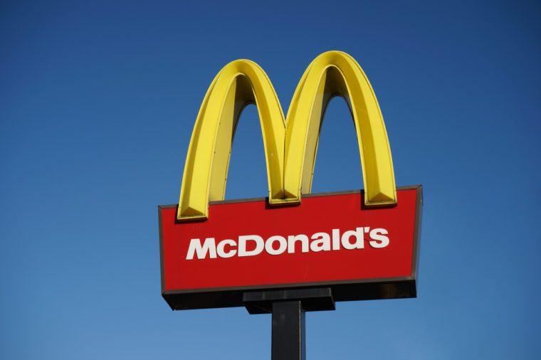 LONDON - DEC 13: McDonalds logo on blue sky background on Dec 13, 2014, London, UK. It is the world's largest fast food chain, over 31,000 restaurants worldwide, serve 58 million customers each day.