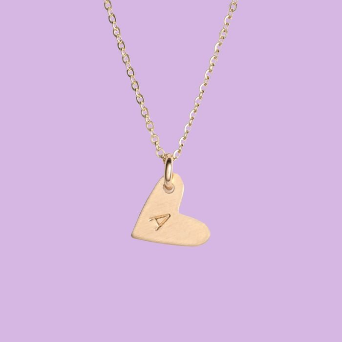 gold heart necklace with initial on it