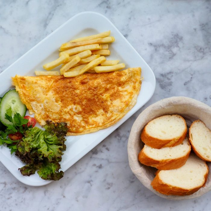 Omelette in a plate on marble background