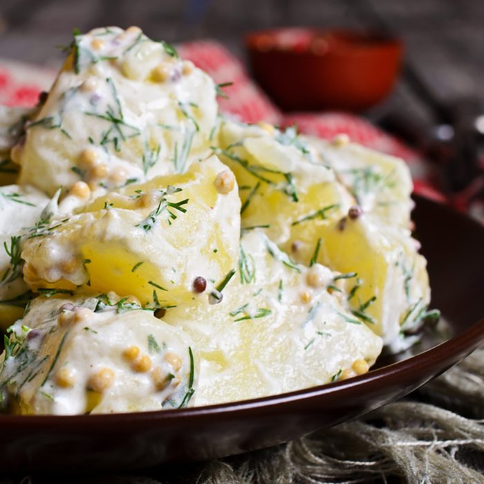 Potato salad with mustard seeds and white filling in rustic style