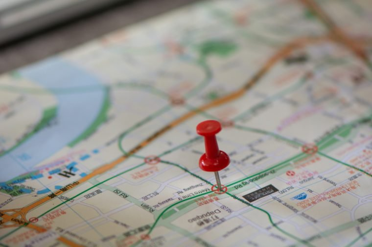 Pointing red pin plan to travel on map, Travel concept