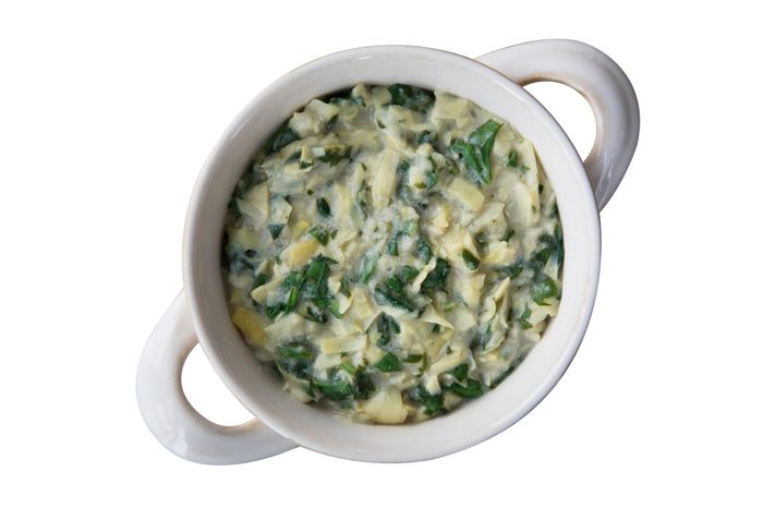 Flat lay of vegan spinach artichoke dip in bowl