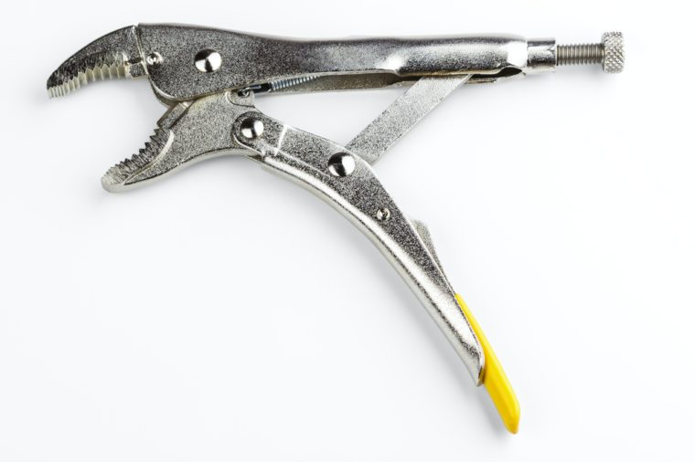 curved jaw locking pliers isolated on white background